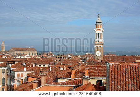 Bell Tower Of Church Of The Holy Apostles Of Christ And Many House In The Cannaregio Sestiere Of The