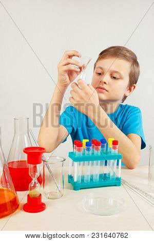 Little Chemist Doing Chemical Experiments In The Laboratory