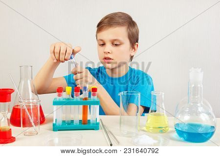 Little Smart Scientist Doing Chemical Experiments In The Laboratory