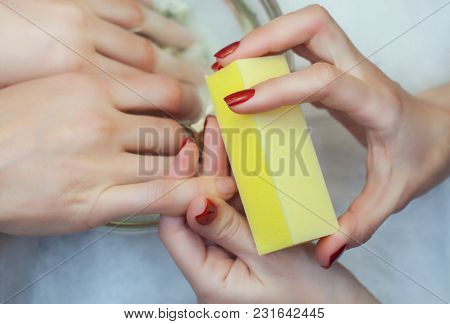 The Master Of The Manicure Saws And Attaches A Nail Shape During The Procedure Of Nail Extensions Wi
