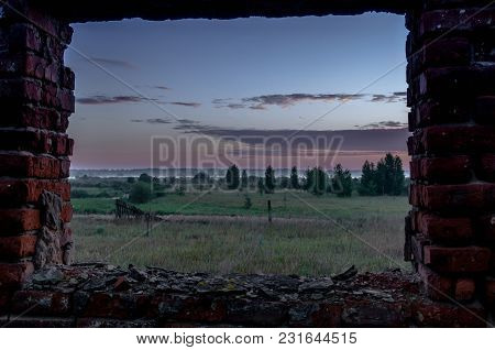 View From The Window Of The Ruins. Observation Of The Sunrise. Window Hole.