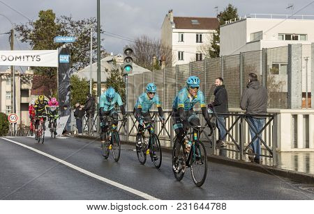 Meudon, France - March 4, 2018: The Cyclists Jakob Fuglsang,magnus Nielsen And Hugo Houle Of Team As