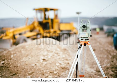 Surveyor Equipment Gps System Or Theodolite Outdoors At Highway Construction Site. Surveyor Engineer