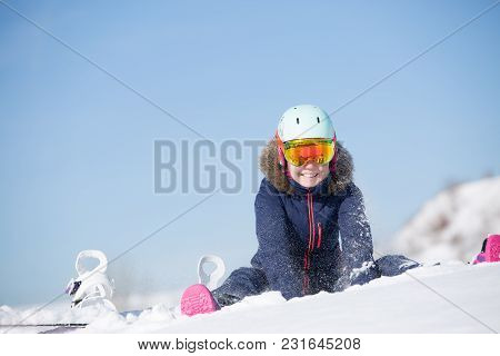 Picture Of Athlete Woman In Helmet Sitting At Snowdrift On Winter