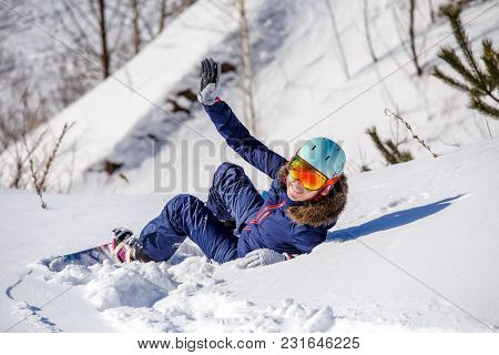 Image From Back Of Athlete In Helmet Lying On Snowy Slope On Winter Day