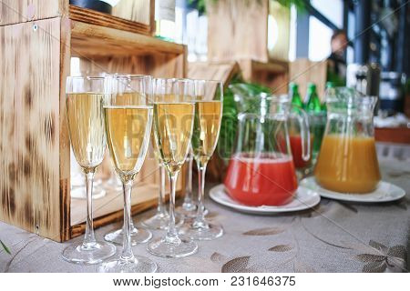 Glasses Filled With White Dry Wine, Drinks For Guests. Closeup.