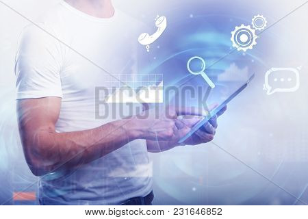 Male Hands Using Device On Abstract Background With Glowing Digtal Interface. Future And Media Conce