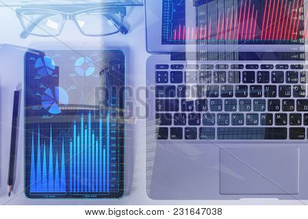 Top View And Close Up Of Tablet With Forex Chart Placed On Office Desk With Supplies And Other Items