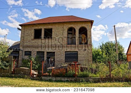 Facade Of A Brown Private Brick House
