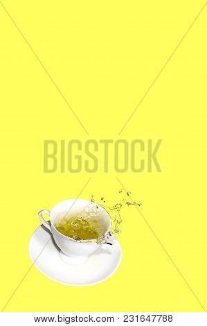 A Tea Set With A Splash Of Tea On White Backgroumd. Negative Copy Space.