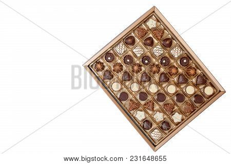 An Open Box Of Expensive Chocolates On A White Background, A Large Selection Of Delicious Chocolate