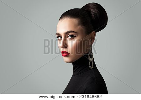 Gorgeous Woman With Perfect Hairstyle And Eyeliner Makeup. Cute Female Model Face