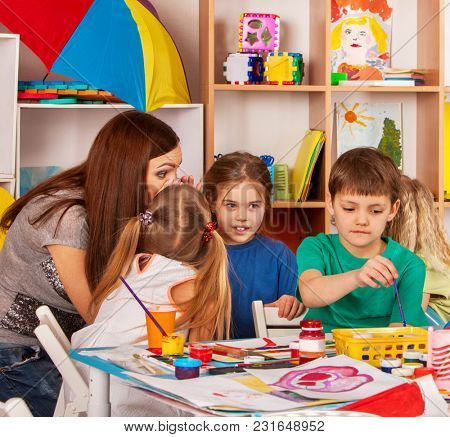 Small students with teacher finger painting in art school class. Break school in painting class. Art children's school. Craft drawing education develops creative abilities of children.