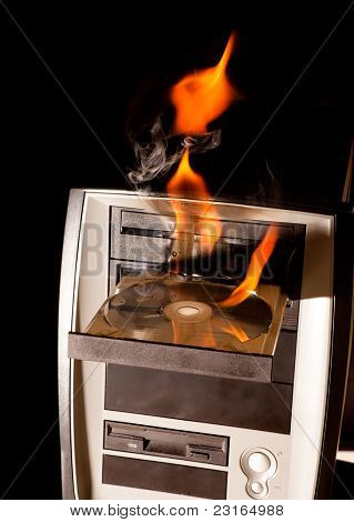 Computer on fire with flames in the cd drive