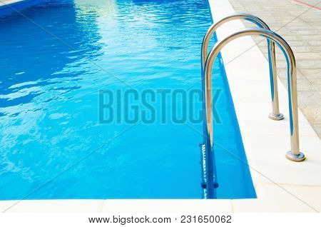 A Pool Stairs With A Blue Water