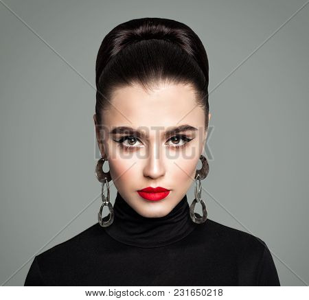 Beautiful Woman With Silver Earrings And Makeup