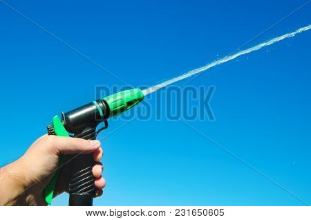 A Hand With A Water Spray Jet