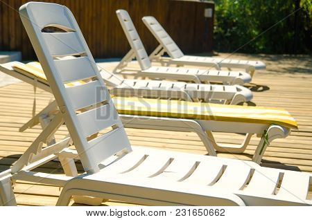 A Chaise Longues In Hotel Near Pool
