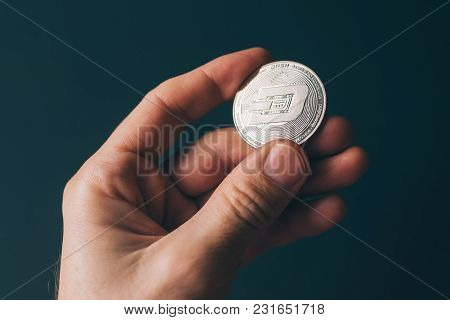 Dash Cryptocurrency In Hand, Blockchain Technology Decentralized Currency Coin