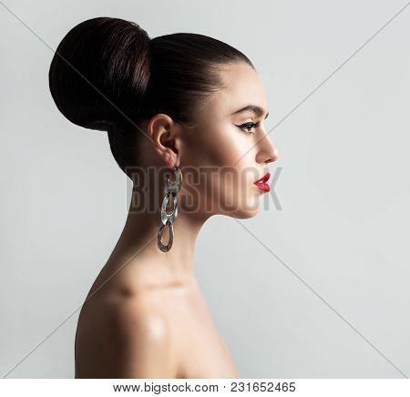 Elegant Fashion Model With Hair Bun Hairstyle On Background