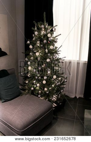 The Corner Of The Bedroom With A Christmas Tree. Festive Design Of Interiors Of Large Hypermarkets.
