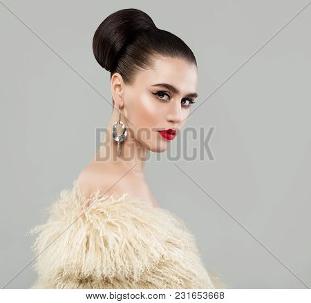 Fashion Portrait Of Elegant Young Woman In White Fur