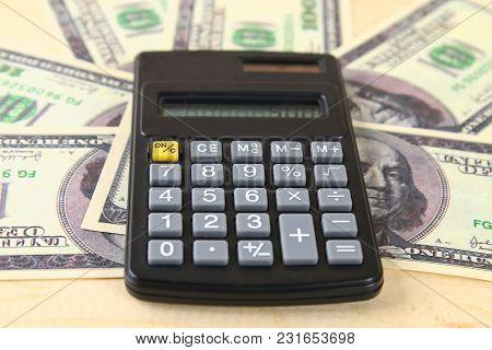 Finance Concept : The United States Hundred-dollar Bills , Calculator , Bills