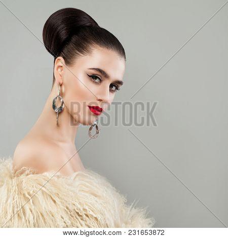 Gorgeous Woman Wearing White Fur. Fashion Beauty Portrait