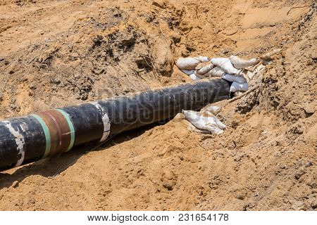 Close Up Large Concrete Pipe Under Loamy Sand Mounds To The Rural Dirt Road