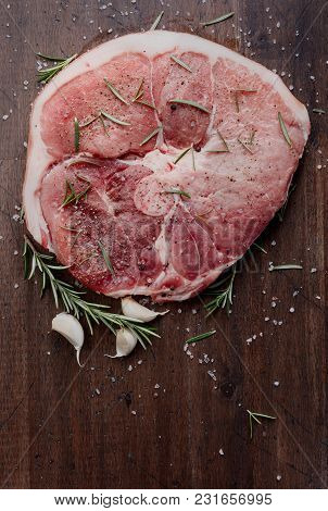 Raw Pork With Rosemary , Salt And Pepper.