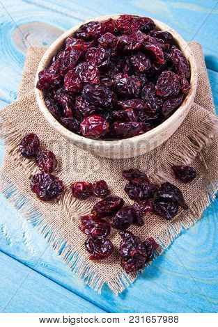 Dried Raw Cranberries Fruit In Bowl On The Wooden Background.