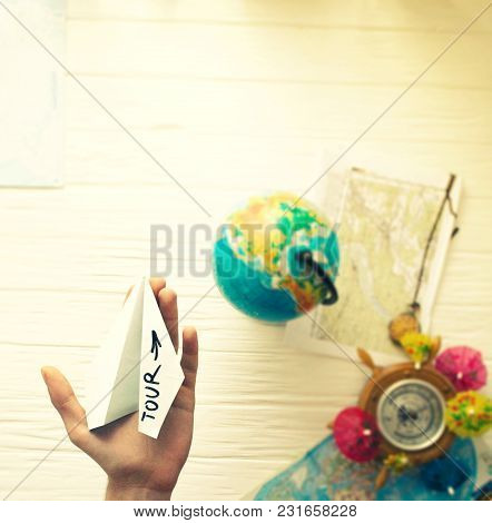 A Man Is Holding A Paper Airplane In His Hand. Still Life Of A Traveler.