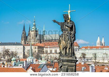 Statue Of Saint, Charles Bridge And Prague Castle, Czech Republic. Travel Destination. Cultural Heri
