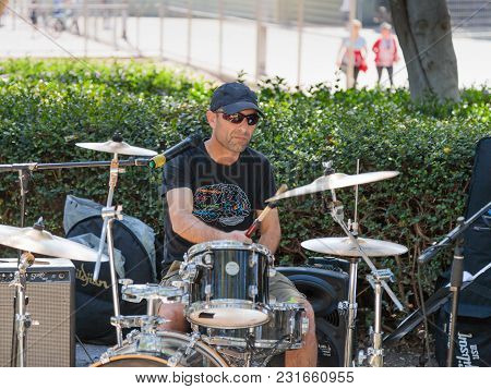 Tel Aviv-yafo, Israel, March 17, 2018 :  A Drummer From A Group Of Street Musicians Plays Music For