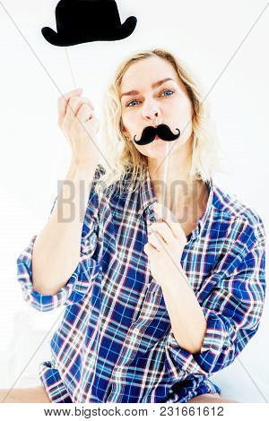 Funny Portrait Of Blond Woman Sitting In Bed With Fake Mustache And Paper Hat