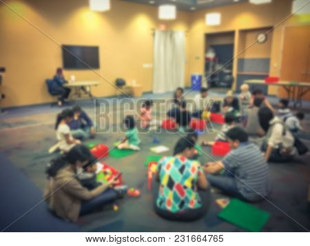 Blurred Motion Kids Playing With Building Toys Blocks At Library In Usa