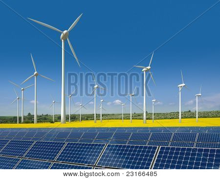 Wind turbines and solar panels in a rapeseed field