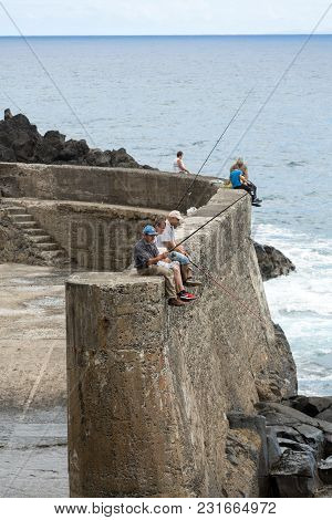 Porto Da Cruz, Madeira, Portugal - September 11, 2016: Fishing Only For The Brave On The Breakwater