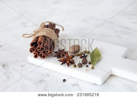 Spices On A White Marble Background. The View From The Top. Copy Space