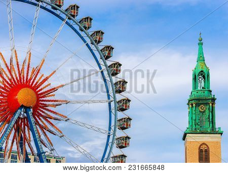 Great Berlin Wheel And St Mary Church In Berlin, Germany