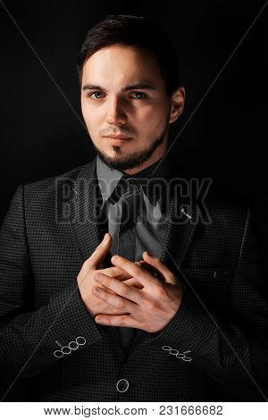 Portrait Of Young And Handsome Businessman Holding A Jacket Isolated On Black Background. Portrait O