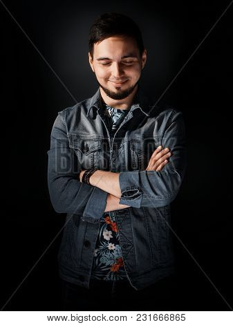 Stylish Guy In A Denim Jacket. Happy Trendy Young Handsome Guy In Glasses And Wearing A Denim Suit S