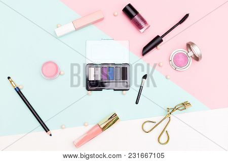 Makeup Tools And Accessory  On Pastel Background. Flat Lay