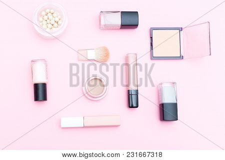 Nude Cosmetics  And Makeup Tools On Pink Background. Flat Lay
