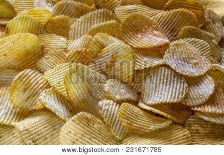 The Background Corrugated Golden Chips With Texture