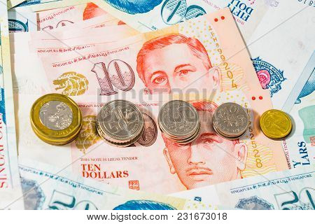 Singapore Dollar Coins And Banknotes On White Background, The Singapore Dollar Is The Official Curre
