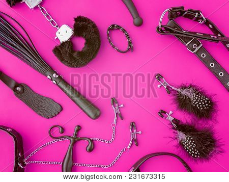 A Variety Of Sex Toys Are On A Purple Background. The Image Is Suitable For Advertising And Promotin
