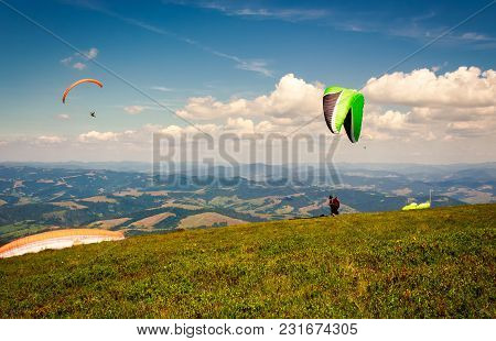 Skydiving  Flying Over The Mountains. Parachute Extreme Sport