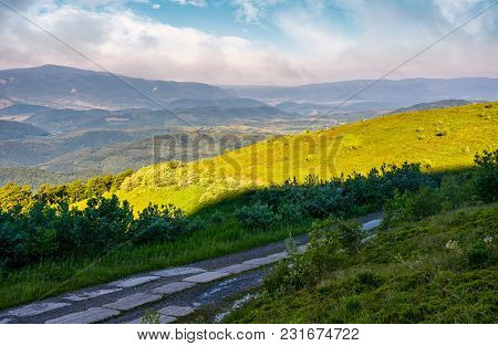 Road In High Mountains In Summer Morning. Beautiful Nature Scenery