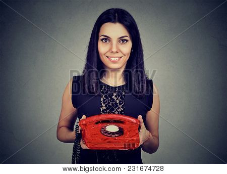 Pretty Young Woman Holding Vintage Red Telephone